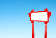 Red blank wooden sign with blue sky Royalty Free Stock Images