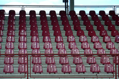 Red bleachers. And empty red seats in a grandstand stock image