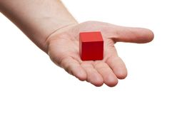 Red block in the hands of Royalty Free Stock Image