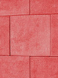 Red Block Wall. Abstract background consisting of a wall of red, textured blocks Royalty Free Stock Images