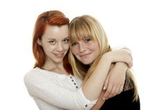 Red and blond haired girls are best friends royalty free stock photography
