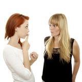 Red and blond haired girls finger mouth secret Stock Photography