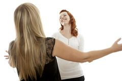 Red and blond haired girls happy to meet you Stock Photography