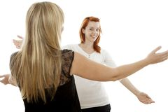 Red and blond haired girls happy to see again royalty free stock photos