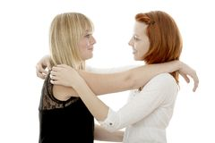 Red and blond haired girls are happy together Stock Images