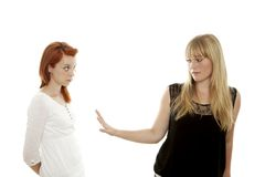 Red and blond haired girls is stuck up Stock Image