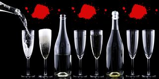 Blood Champagne. Red blood above champagne glasses in a gothic celebration stock photo