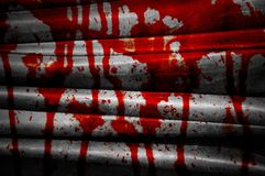 Red blood on grunge fabric Stock Photo