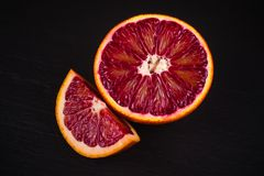 Red blood sicilian orange wedge and half Royalty Free Stock Photos