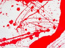 Red blot and splatter paint on white background. Red blot and splashes of paint on a white background. expressionism stock photo