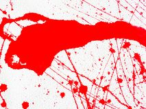 Red blot and splatter paint on white background. Red blot and splashes of paint on a white background. expressionism royalty free stock image