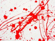 Red blot and splatter paint on white background. Red blot and splashes of paint on a white background. expressionism royalty free stock photography