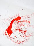 Red blot and splatter paint on white background. Red blot and splashes of paint on a white background. expressionism. vertical royalty free stock photo