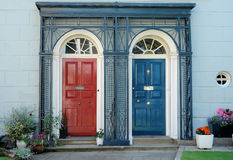 Red and Blue. Two colorful doors next to each other in a town in southwest Wales Royalty Free Stock Photos