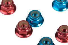 Red and blue aluminium nuts Stock Images