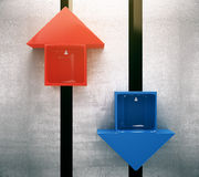 Red and blue arrow lifts Stock Images