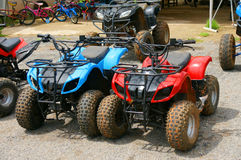 Red and blue ATV quad bike in Thailand. Royalty Free Stock Photography