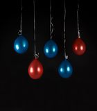 Red and blue balloons isolated in dark background, studio light, selective focus Royalty Free Stock Photo