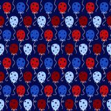 Red and Blue Balloons Seamless Pattern. Colorful red and blue balloons with star designs and string on navy blue background seamless pattern Stock Photos