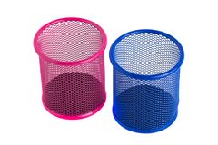 Red and blue basket for pens and pencils on the white background Royalty Free Stock Photography