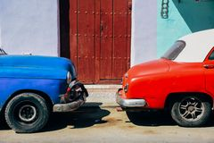 A red and blue classic car parked in Havana, Cuba. stock images