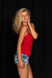 Red and blue. Beautiful tall German blonde in red and blue royalty free stock photos