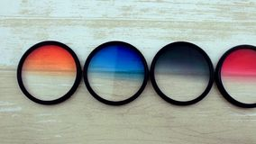Red, blue, black, orange filter. The filter for a camera lens stock video footage