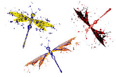 Red blue black yellow paint made dragonfly set. Three pieces Stock Photo