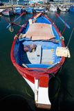 Red and blue boat on the Mediterranean Sea, Corsica, France, Europe Stock Photos