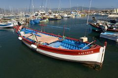 Red and blue boat on the Mediterranean Sea, Corsica, France, Europe Royalty Free Stock Photography