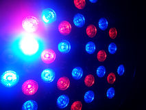 Red and blue bokeh lights in the dark Royalty Free Stock Image