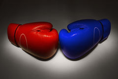 Red and Blue boxing gloves. Red glove lay across from of blue gloves, as a way of(metaphor) opposition and fighting royalty free stock photography