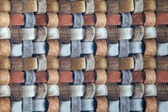 Red blue and brown wicker fabric canvas for upholstery furniture. Bright red blue and brown wicker fabric canvas for upholstery furniture indoor closeup royalty free stock photo