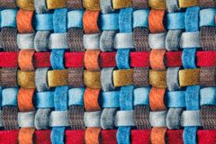 Red blue and brown wicker fabric canvas for upholstery furniture. Bright red blue and brown wicker fabric canvas for upholstery furniture indoor closeup royalty free stock image