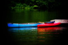 Red and Blue Canoe. On the lake Stock Photo