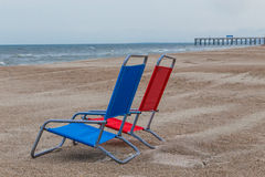 Red and Blue Canvas Beach Chairs Royalty Free Stock Photography