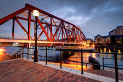 Red and blue cast iron bridge at Salford Quays Stock Image