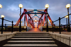 Red and blue cast iron bridge and steps at Salford Stock Images