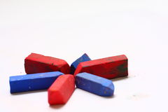 Red and Blue Chalk Pastels. A few used colored chalk pastels on white Stock Photography