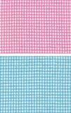 Red blue checkered. Two kinds of checkered fabric, pink and light blue Royalty Free Stock Photography