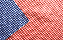 Red and blue checkered patterned tablecloth. Background red and blue checkered patterned tablecloth for a oktoberfest decoration Royalty Free Stock Image