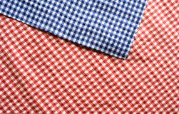 Red and blue checkered patterned tablecloth. For a oktoberfest concept Stock Photos