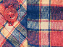 Red and blue checkered shirt, background in vintage colors Royalty Free Stock Image