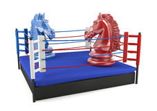 Red and blue chess knight confronting in boxing ring Stock Images