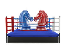 Red and blue chess knight confronting in boxing ring Royalty Free Stock Images