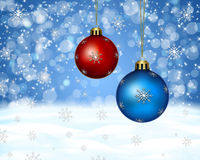 Red and blue christmas balls. On snowy background Royalty Free Stock Image