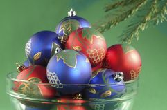 Red and blue Christmas ornaments. Bowl of red and blue Christmas ornaments Royalty Free Stock Photos
