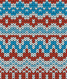 Red and blue Christmas seamless pattern. Knitting  traditional texture.   Winter background. Royalty Free Stock Photo