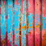 Red and blue color paint on metal wall Royalty Free Stock Photo
