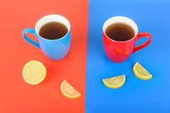 Red and blue cups with tea on a red and blue background. Flat la. Y,top view. Free space for text Stock Photography
